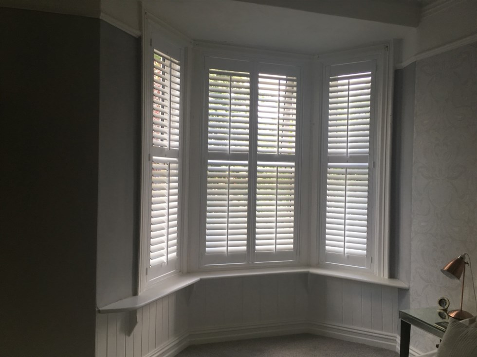 bay window no unsightly gaps and a midrail positioned so the top panels can be opened and closed seperately to the bottom panels these shutters come